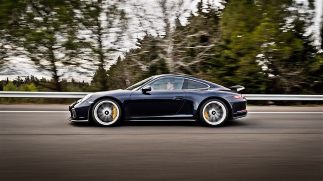 Flaunting a huge rear wing, giant air intakes, and fender-filling wheels and tires, there's no mistaking the 911 GT3 for anything but the track-ready racer it is.
