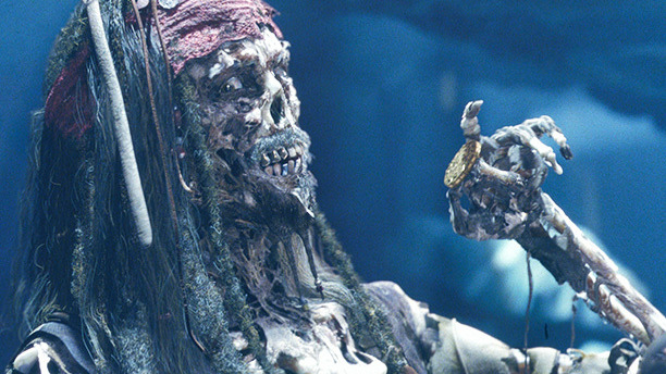 Disney's Pirates of the Caribbean ride was a legendary ritual for generations of kids – at once scary and delightful, it was a morbidly funny G-rated horror show. Director Gore Verbinski translated that sensibility perfectly with Black Pearl's living skeletons: anatomically detailed, ghoulishly organic, yet animated with a playful touch.