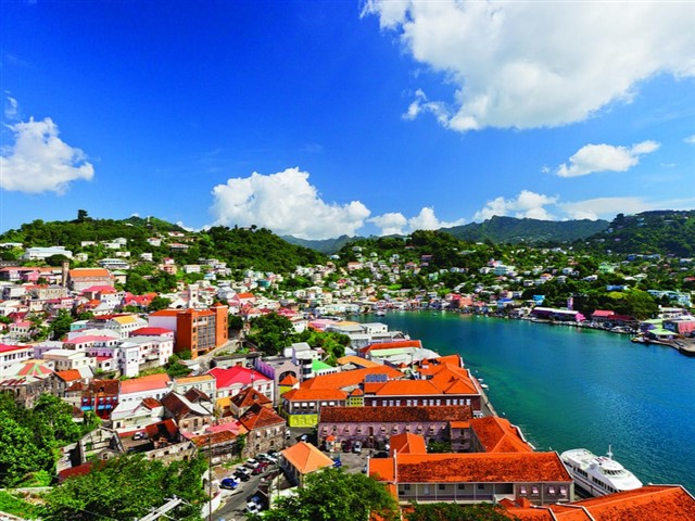 Grenada is the Spice Isle: a land of nutmeg and vanilla pods and fragrant wafts of cinnamon that twist and turn in the sultry Carib air, rolling down in breezes with the trade winds to the pretty bays of Grand Anse and the shiny white sands of Morne Rouge Beach.Volcanic in origin, the island spikes and dips with the cones of Mount Saint Catherine and the grass-rimmed crater lakes of Grand Etang alike.Waterfalls gush and carve the landscapes too, running swiftly over the rocks at Royal Mount Carmel and flowing in moss-clad steps at the Seven Sisters, accessible only by winding hiking trails through the mountains.Oh, and let's not forget the human side of things: the lively local fish fries of Gouyave; the River Antoine brewing house – home to some of the oldest rum labels in the world.