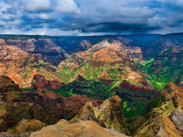 Just a few miles inland of the Na Pali Coast of Kauai is Waimea Canyon. Also known as the Grand Canyon of the Pacific, Waimea Canyon is one of the most amazing places to visit in Hawaii. The staggering size draws definite parallels to the Grand Canyon, but Waimea Canyon may be even more beautiful thanks to plenty of greenery among the desert-like landscape. Clouds often roll in during the afternoon, so the clear mornings are the best time to explore the canyon with a hike through Koke'e State Park. Camping is also possible for the intrepid traveler, allowing you to be there for the glorious sunrise in the morning.