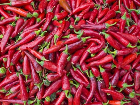 Spicy food warms you up, gets your heart pumping, stimulates nerve endings and increases the blood flow, so there might be some truth to this one. Just make sure you wash your hands after...