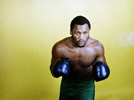 Joe Frazier has been known as the toughest rival of Muhammad Ali. He is an Olympic gold medalist and a world champion who lived in the glory days of the heavyweight division. Smokin Joe is a star pupil of Eddie Futch, a boxing trainer known as a tactician for his methodical approach in training fighters.Frazier has been known for his body punches, unrelenting attacks and extreme durability. He was able to fight Oscar Bonavena, Buster Mathis and Doug Jones even defeating Muhammad Ali in one occasion.But what defined Joe Frazier's career is his historic Thrilla in Manila rubbermatch against Muhammad Ali. Thrilla in Manila took place in Araneta Coliseum in Manila, Philippines. Thrilla in Manila is considered by many as the greatest boxing match in history. It has even been used by anti-boxing advocates in their attempts to ban boxing as a sport. Smokin Joe eventually retired one match after Thrilla in Manila. He died in 2011 with liver cancer.