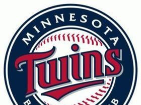 The Minnesota Twins are a professional baseball team based in Minneapolis, Minnesota. They play in the Central Division of Major League Baseball's American League. The team is named after the Twin Cities area comprising Minneapolis and St. Paul. They played in Metropolitan Stadium from 1961 to 1981 and the Hubert H. Humphrey Metrodome from 1982 to 2009. They played their inaugural game at the newly completed Target Field on April 12, 2010.
