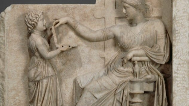 "Around 100 BC, an upper-class Greek woman died. Her tomb included a beautiful relief scene that showed the deceased sitting in comfort with a child in attendance. What caught the attention of conspiracy theorists was the object being held by the little girl. They claimed that she was holding an open laptop computer for the woman.It looked like the woman was about to type in her Facebook password. Speculation went as far as identifying USB ports and suggesting that the statue was a prophecy of the Oracle of Delphi, who might have foreseen computers.Historians are not impressed because the general agreement maintains that the object is a box. Experts at J. Paul Getty Museum, which owns the relief, suggested that it could be a jewelry case or a hinged mirror. The latter really existed during the woman's time.A professor from the University of Oregon had a look at the so-called ""USB ports"" in the artifact's side. He identified them as drill holes meant to support an additional piece of art. Other scholars have reason to feel that there is no mystery. In similar funeral monuments, women are commonly shown in the act of selecting jewelry."