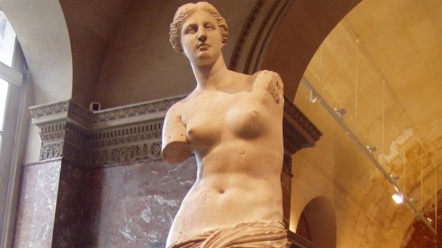 This sculpture has survived for over 2100 years, with the exception of the original arms. It dates all the way back to between 100 and 130 B.C., and depicts Aphrodite (or Venus to the Romans), the Greek goddess of love and beauty. Made of marble, it is slightly larger than life size, and is one of the most famous ancient Greek sculptures. It was discovered in a farmer's field in the Greek island of Milos in 1820, and soon acquired by France.