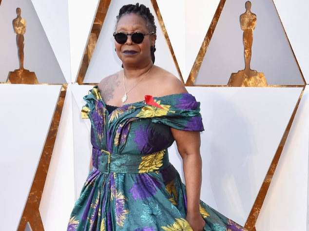 It's as if Whoopi was rummaging in the dress up box from a down-on-its-luck medieval pantomime then decided to get a boss hairdo to modernise it. Having said that, we love a strong look.