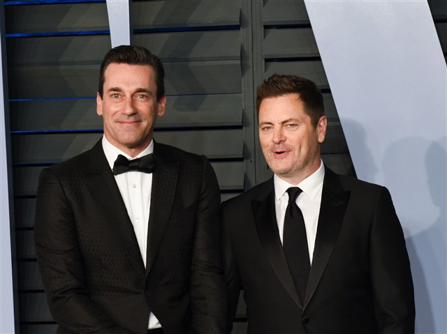 When Megan Mullally was doing her solo shots, her husband Nick Offerman and Jon Hamm held hands behind her.