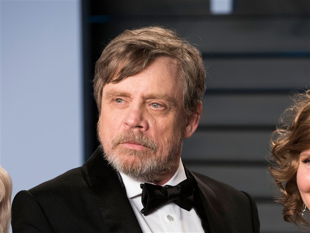 Mark Hamill held his hands in the air and mimed holding an Oscar.