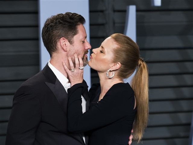 Amy Adams and her husband were very cute on the carpet.