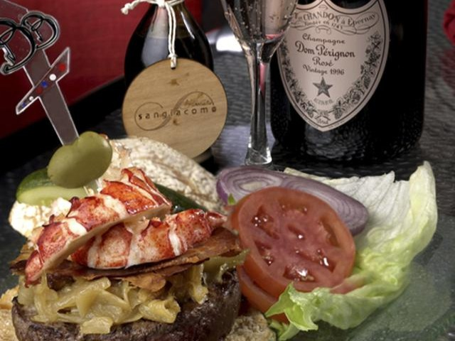 $70 or $777 paired with a bottle of Dom PérignonLe Burger Brassiere, Las VegasThis expensive Kobe beef burger also features Maine lobster topped with caramelized onions, Brie, crispy prosciutto and 100-year aged balsamic vinegar. The bottle of Rosé Dom Pérignon champagne may actually contribute as much as the burger to the price though.
