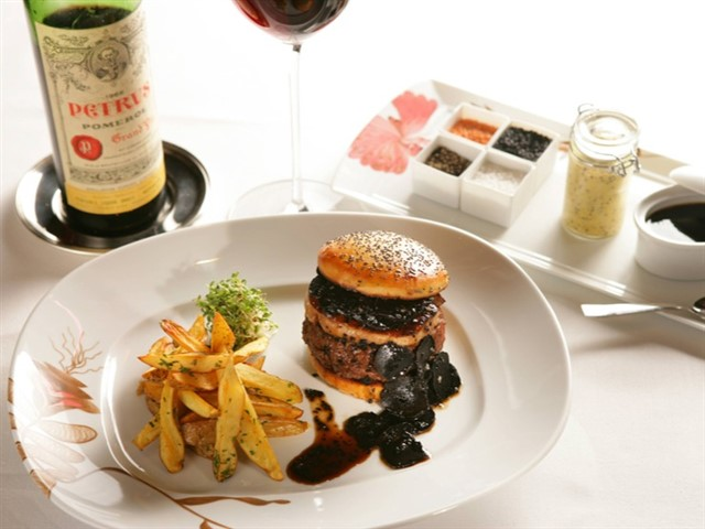 $75 (or $5000 when paired with wine)Fleur, Las VegasHubert Keller originally gained burger fame for The Fleurburger which was served in his Las Vegas restaurant Fleur de Lys (now renamed simply Fleur). The burger could be ordered by itself for a mere $75.But, if you were inclined to drop $5,000 on a meal, and enjoyed Bordeaux wine, you could order the burger with a bottle of 1990 Château Pétrus wine. As part of the meal you received a certificate to prove that you ate the world's most expensive hamburger and wine pairing.The burger itself was made of Kobe beef and topped with foie gras and black truffles and served on a brioche truffle bun and garnished with a sauce containing even more truffles.
