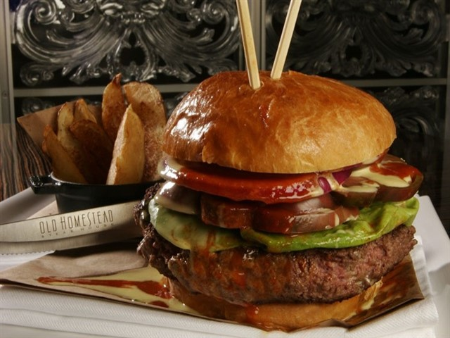 $125The Old Homestead Steakhouse, Boca RatonThis expensive burger was created in 2006 at the Old Homestead Steakhouse in Boca Raton, Florida. Called the Tri-Beef Burger, the burger was made of a blend of three different kinds of beef—American Prime, Japanese Wagyu and Argentine beef. The hamburger was served with signature Chipotle ketchup which included the ingrediants truffles and champagne. The restaurant's owners donated $10 of every sale of the $125 burger to the Make-A-Wish Foundation.Don't worry too much if you missed this burger in 2006, if you visit one of the Old Homstead Steakhouse locations today you can still order a 20oz Kobe burger for about $40.