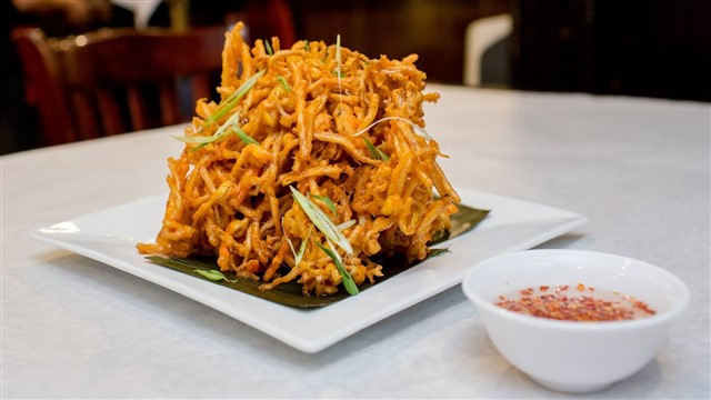 """Specializing in Filipino comfort foods, Tito Rad's Grill aims to """"satisfy your craving for luting bahay,"""" or a taste of home. Wherever you call home, you're sure to savor the grill's coconut milk tuna belly, soy sauce and vinegar-braised pork, whole fried pompano, and more."""