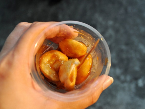 Ironically, most fish balls are more of a flattened shape. Essentially, this is ground up fish meat combined with some fillers. It is pre-shaped and then deep-fried by the vendors on their food carts.