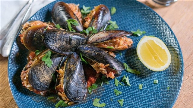 Mussels filled with herbed rice, currants, and pine nuts are another classic street food, and the vendor will continue handing you a new one with a spritz of lemon until you say stop.