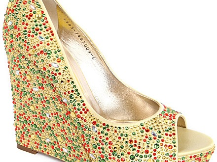 "Another venerable British department store provides the next item, and that's the Gina court shoes, available at Selfridges for just $2100. Like the perfume, they are gold, to show off just how expensive they are, and they are tastefully decorated from wedge-heel to peeptoe in hundreds of Swarovski crystals in red, green and gold. They would make an excellent Christmas present because, let's face it, when else in the calendar can you get away with wearing gold, red and green together? Especially in an unyielding wall of bling? Selfridges says they are a ""walking style-statement"". I say for that kind of money you'd expect a more comfortable looking insole and a less plastic-y heel tip. But maybe that's just me…"