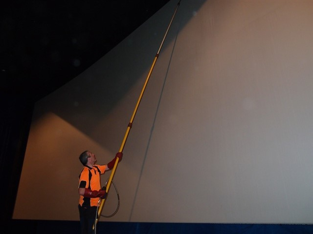 All the theaters with huge screens wouldn't look near as great with a layer of dirt and dust on the screen. Fortunately, there are people who are tasked with the job of screen cleaning. Screen cleaners use scaffolding to reach the highest places, and the screens accumulate so much dust that they usually have to empty their vacuum cleaner two or three times per screen.