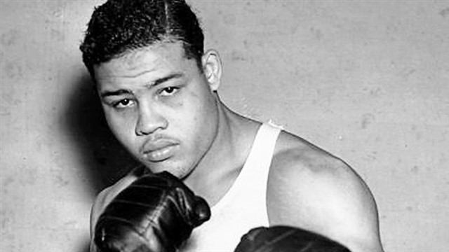 """Joe Louis was the first African-American athlete to receive crossover appeal in mainstream America, earning reverence from black and white people alike. His astounding wins as a heavyweight champion got him the name """"The Brown Bomber,"""" a man who, no matter what a boxing match or life threw at him,always rebounded. He even famously overcame his only boxing defeat with German fighter Max Schmeling in a much-publicized 1938 rematch. To many Americans, this rematch represented the United States overcoming Nazi Germany.Growing up in poverty, Louis started training at around 10 years old. Though he was the top boxing champion from 1937 to his 1949 retirement, Louis maintained his characteristic integrity, which instilled dignity in a sport long riddled withbrutal violenceand gambling."""