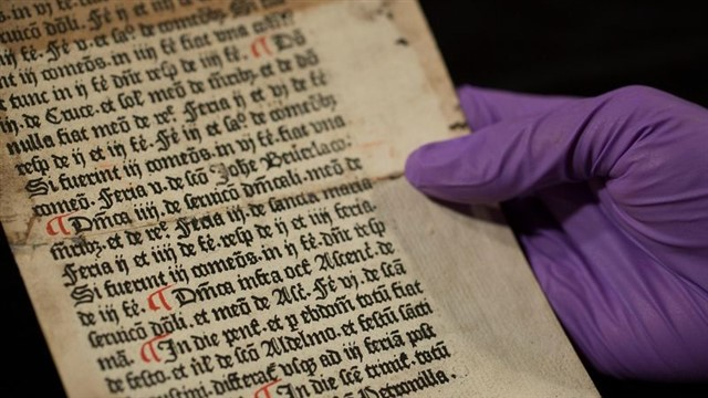 """Printed between 1476 and 1477, the """"Sarum Ordinal"""" or """"Sarum Pye"""" was a handbook written in Latin by St. Osmund, an 11th-century bishop. It was a guide for priests on what to wear and which Bible texts to use during religious festivals. At some point the page was ripped from the now-missing book and used to strengthen another's spine.There it remained for 300 years until a librarian rescued it in 1820. However, not realizing it was an unknown Caxton leaf, the person stored it and another 200 years passed. Despite its age, getting torn and pasted into another book, the leaf is in good condition. The only other remains of a Caxton printed Sarum Ordinal are eight pages kept at the British Library in London."""