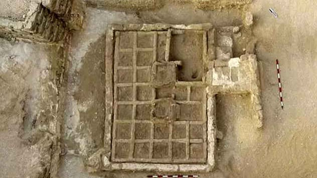 Found outside the entrance of a 4,000-year-old tomb, the garden was a neat, rectangular structure, 3 m x 2 m x half a meter high (10 ft x 6.5 ft x 1.6 ft). Inside were rows of 30 cm2 (4.65 in2) blocks. One corner bed holds a tamarisk shrub and a bowl with fruit, perhaps given as an offering. Two trees flank the garden and more probably stood at its raised center.Additional research is needed to find out what else grew in the grid but experts believe the plants were chosen based on their connections to Egyptian religious beliefs. Possible species are sycamore, palm, and Persea trees, even lettuce since they all symbolized renewal and resurrection. The unique garden was the first time iconography was confirmed by a physical discovery, and the find could also reveal what Thebe's environment, botany, and religion entailed during a crucial time when the kingdoms of Upper and Lower Egypt merged.