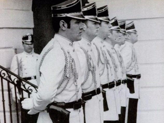 In January 1970, Richard Nixon introduced new uniforms to replace the black ceremonial uniforms of the Secret Service agents guarding the White House. Nixon felt the old uniforms weren't cool enough, and he had gotten the idea of these cooler uniforms from what he had seen in Europe. He was also hoping to impress British prime minister Harold Wilson, who was being expected for a state visit, with the new uniforms.