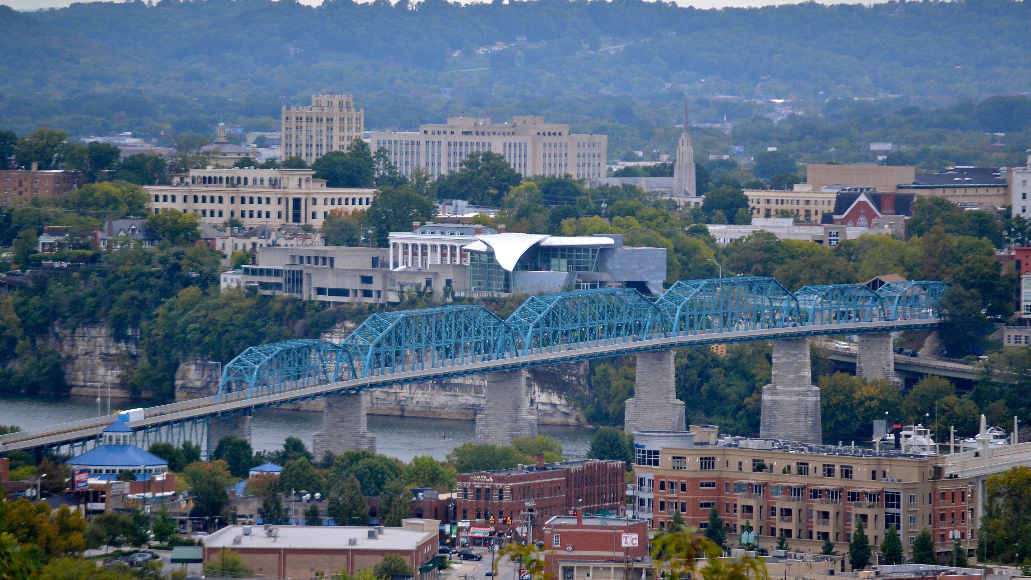 Chattanooga is a city located along the Tennessee River near the southeastern corner of the U.S. state of Tennessee. With an estimated population of 179,139 in 2017,[8] it is the fourth-largest city in Tennessee and one of the two principal cities of East Tennessee, along with Knoxville. Served by multiple railroads and Interstate highways, Chattanooga is a transit hub. Chattanooga lies 120 miles (190 km) northwest of Atlanta, Georgia, 120 miles (190 km) southwest of Knoxville, Tennessee, 135 miles (217 km) southeast of Nashville, Tennessee, 120 miles (190 km) northeast of Huntsville, Alabama, and 148 miles (238 km) northeast of Birmingham, Alabama.