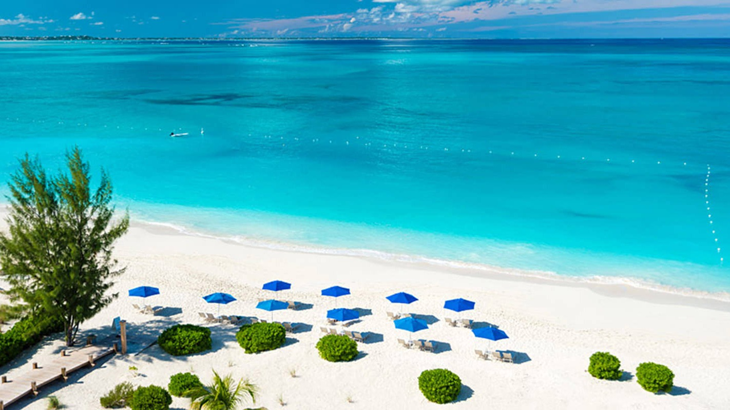 The Turks and Caicos Islands (/tɜːrks/ and /ˈkeɪkəs, -koʊs, -kɒs/), or TCI for short, are a British Overseas Territory consisting of the larger Caicos Islands and smaller Turks Islands, two groups of tropical islands in the Lucayan Archipelago of the Atlantic Ocean and northern West Indies. They are known primarily for tourism and as an offshore financial centre. The resident population is 31,458 as of 2012[2] of whom 23,769 live on Providenciales in the Caicos Islands.https://en.wikipedia.org/wiki/Turks_and_Caicos_Islands