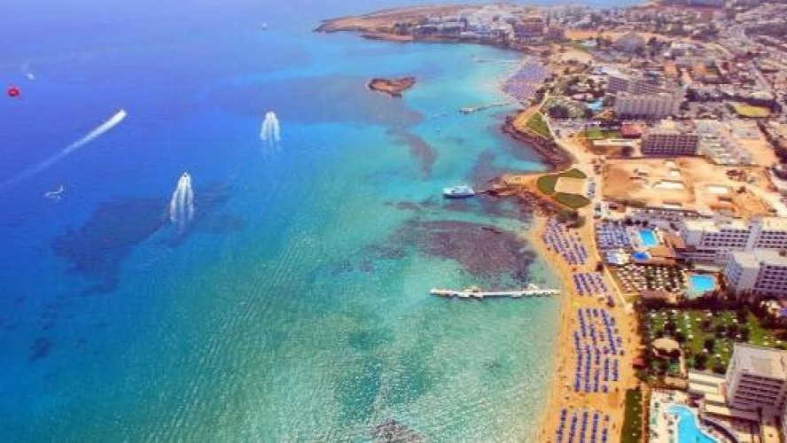 Fig Tree Bay is a sandy beach in the resort of Protaras, Cyprus. In 2011, TripAdvisor declared it to be the third best beach in Europe,[1] but it dropped to 13th place in 2013.[2]As with all beaches in Cyprus, access to the public is free, whilst bed and umbrella hire is chargeable. A municipal car park provides parking within a short walk. The sandy beach stretches for 500m and the waters are clean enough for the beach to have been awarded blue flag designation.[3] The beach, which runs the length of its own cove, takes its name from the fig trees located close to the coast.https://en.wikipedia.org/wiki/Fig_Tree_Bay