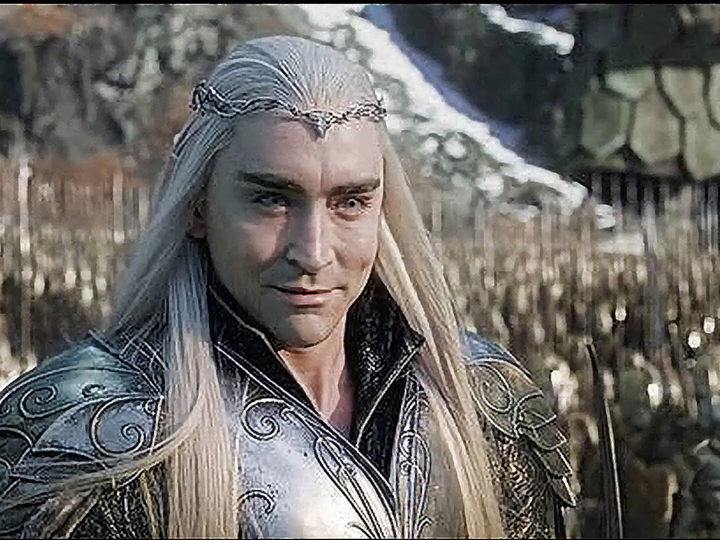 Thranduil is a fictional character in J. R. R. Tolkien's Middle-earth legendarium. He is a supporting character in The Hobbit, where he is referred to as the Elvenking, and he figures briefly in The Lord of the Rings, The Silmarillion, and Unfinished Tales. Tolkien describes Thranduil as having a crown made of red leaves and berries in the autumn, and wearing a similar crown of flowers in the spring. Like most of the Sindar, he would have been beardless, tall, and grey-eyed. The name