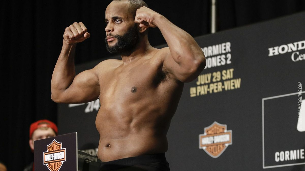 Daniel Cormier[7] (born March 20, 1979) is an American mixed martial artist and former Olympic wrestler. He is currently signed to Ultimate Fighting Championship (UFC), and is champion of both the light heavyweight and heavyweight divisions. As of August 28, 2018, he is the number 1 ranked Pound-for-Pound (P4P) fighter in the UFC.[8] Cormier is the second of two fighters in UFC history to hold titles in two weight classes simultaneously. Prior to the UFC, Cormier was Strikeforce Heavyweight Grand Prix Champion and King of the Cage Heavyweight Champion. He holds the distinction of having won a world championship belt in every promotion for which he has fought. Cormier is considered to be among the greatest mixed martial artists of all time.Source: https://en.wikipedia.org/wiki/Daniel_Cormier