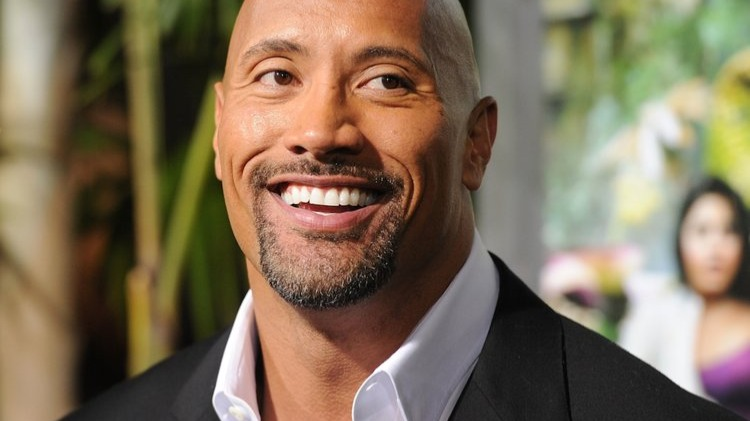 Dwayne Douglas Johnson (born May 2, 1972), also known by his ring name The Rock, is an American actor, producer, and semi-retired professional wrestler.Johnson was a college football player for the University of Miami, where he won a national championship on the 1991 Miami Hurricanes team. After being cut from the Calgary Stampeders of the CFL two months into the 1995 season, he began training for a career in professional wrestling, following in the footsteps of various family members, including his grandfather Peter Maivia and his father, Rocky Johnson, from whom he inherited Canadian citizenship in 2009.Source: https://en.wikipedia.org/wiki/Dwayne_Johnson