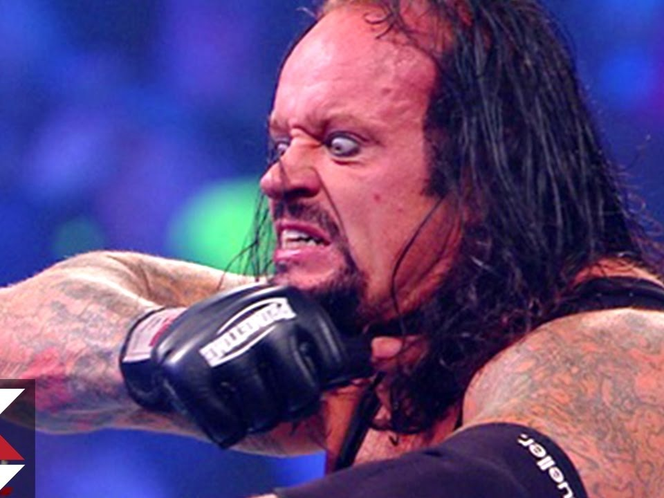 Mark William Calaway (born March 24, 1965),[7] better known by the ring name The Undertaker, is an American professional wrestler currently signed to WWE[5] as a free agent.Source: https://en.wikipedia.org/wiki/The_Undertaker
